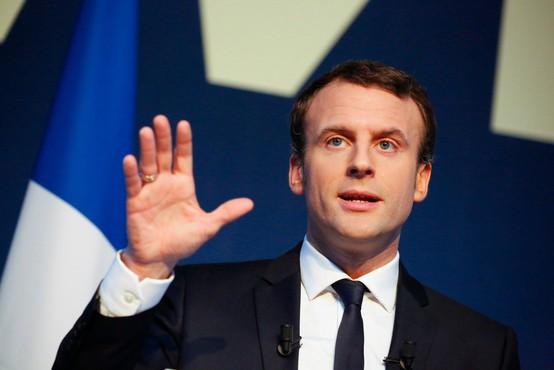 Macron: Protestniki so prestopili mejo, nobenega opravičila ni za ropanje trgovin in napade na policiste