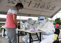 Kitajci zaradi novih okužb zaprli okraj Anxin, ki oskrbuje Peking s sadjem in zelenjavo