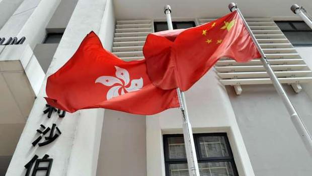 Policija v Hongkongu izvedla prvo aretacijo v okviru novega zakona o nacionalni varnosti (foto: Xinhua/STA)