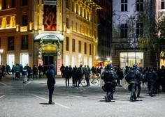 Na četrtkovih protestih do nezavesti pretepen fotoreporter, poškodovanih 15 policistov, škoda tudi na infrastrukturi