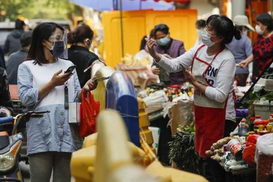 Misija WHO ob svojem obisku na Kitajskem ni uspela identificirati živalskega izvora novega koronavirusa